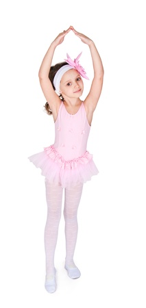 Full-length portrait of a little girls practicing her ballet kicks on a white background Stock Photo - 9715875