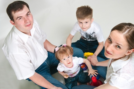 The image of a happy family on a white background photo