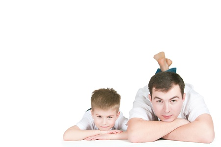 The father with the son lie on a white background Stock Photo - 10850184