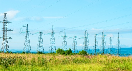 Very wide angle view of high voltage power pylons Stock Photo - 11263223