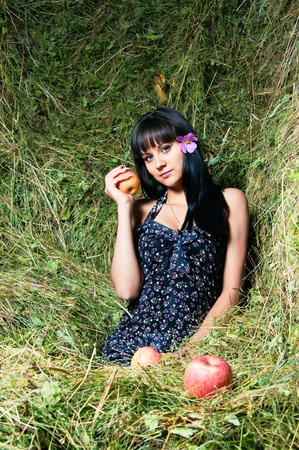 The young woman relaxing on hayloft photo
