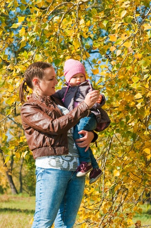 The young woman with the daughter on walk in park Stock Photo - 11745624