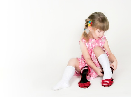 The little girl dresses mums shoes photo
