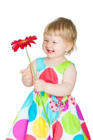 The image of the little girl with a flower in hands photo