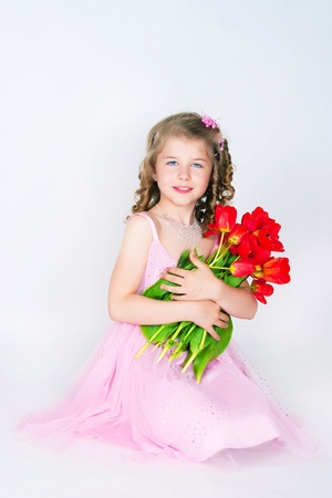 The girl in a pink dress on a white background photo