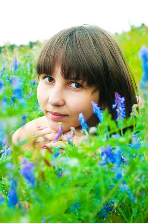 The image of the beautiful girl on a meadow photo