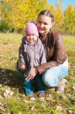 The young woman with the daughter on walk in park Stock Photo - 12633053