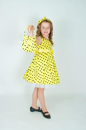 yellow dress: The elegant girl in a yellow dress