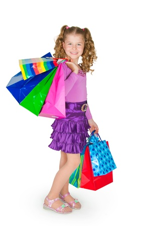 The girl holds many color paper packages photo