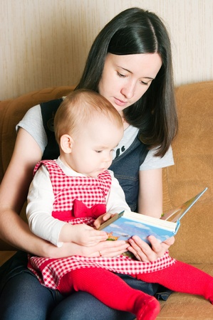 Mother reading to young daughter Stock Photo - 12883044
