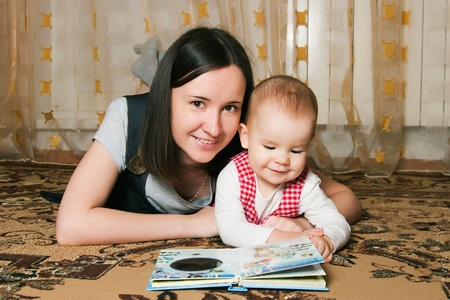 Mother reading to young daughter Stock Photo - 12883030