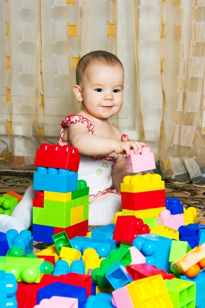 Little girl playing with blocks Stock Photo - 12883002