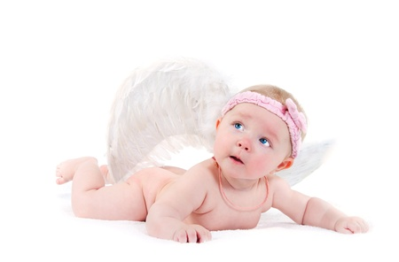 lovely baby with wings of an angel on a white background photo