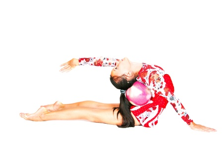 Beautiful Asian girl gymnast with a ball on white background Stock Photo - 13100038