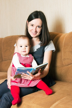 Mother reading to young daughter Stock Photo - 13443946