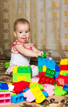 Little girl playing with blocks photo