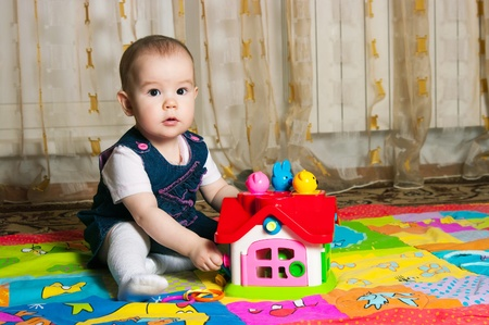 Little girl playing with toys home photo