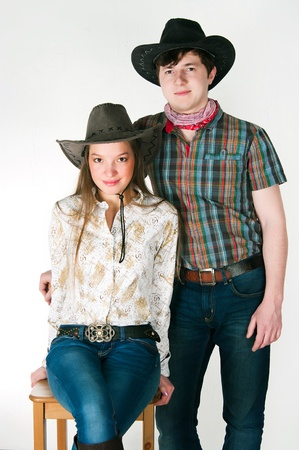 The guy and the girl in cowboys suits on a white background photo