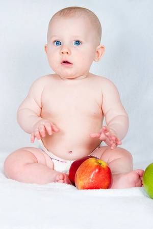 the amusing kid iwith fruit on a light background Stock Photo - 14055297