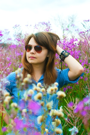 The image of the beautiful girl on a meadow Stock Photo - 14382175