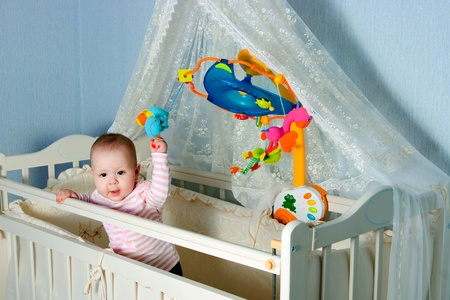 The image of the child in childrens to a bed photo