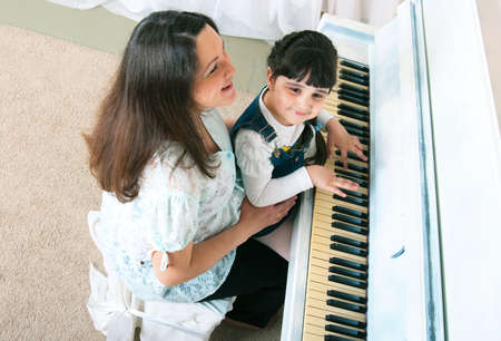 Mother and daughter enjoying their afternoon piano lesson photo