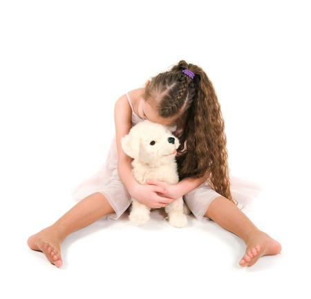 liying: The girl with a toy puppy on a white background