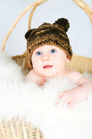 the amusing kid in a hat  on a light background photo