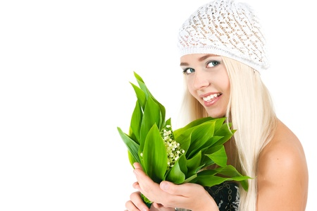The image of the blond girl with a bouquet of lilies of the valley on a white background Stock Photo - 16289725