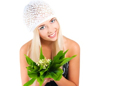 The image of the blond girl with a bouquet of lilies of the valley on a white background Stock Photo - 16289666