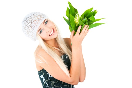 The image of the blond girl with a bouquet of lilies of the valley on a white background Stock Photo - 16289665