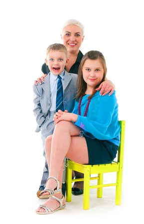 Young mother with two children on a white background photo
