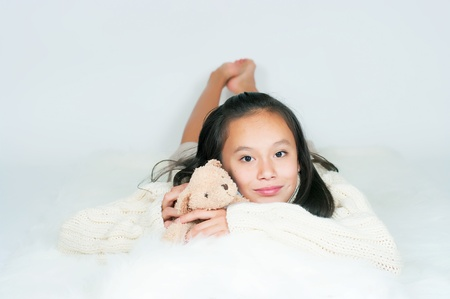 The beautiful Asian girl in a knitted sweater photo
