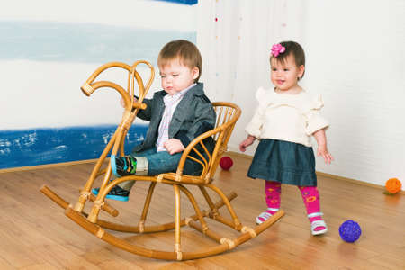 The image of the little girl on a horse rocking chair