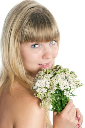 The girl with flowers on a white background Stock Photo - 17993139