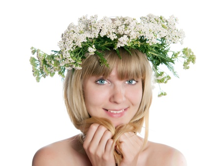 The girl with yarrow wreath on the head Stock Photo - 17993040
