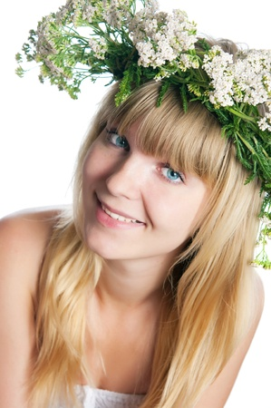 The girl with yarrow wreath on the head photo