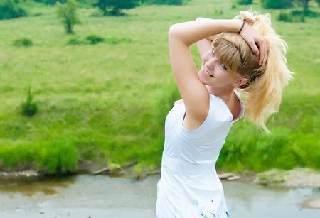 sundress: The girl in a white sundress against nature