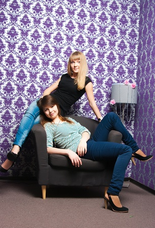 The fashionable girls on a brown chair photo