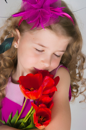 Image of the beautiful girl and bouquet of tulips photo