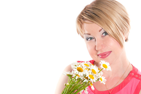 average woman: The image of the positive woman of average years with a bouquet of camomiles Stock Photo