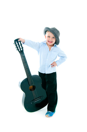 boy in a hat on  white background with gitar