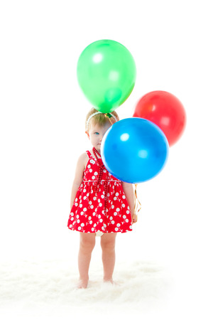 barefooted: the girl with balloons on a white background