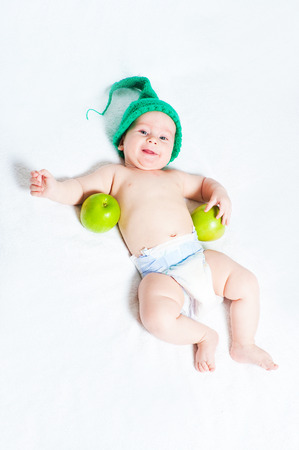 only one boy: The kid in a green cap with apple