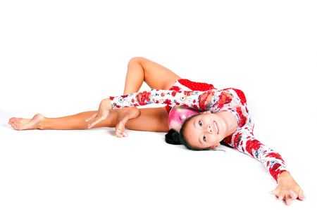 Beautiful Asian girl gymnast on white background photo