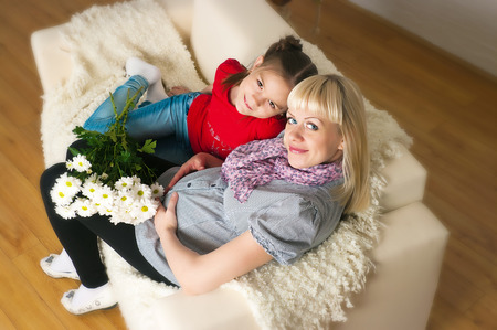listened: A pregnant woman and her eldest daughter Stock Photo