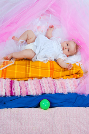 attributes: the image of the girl in attributes of the fairy tale The Princess on a Pea