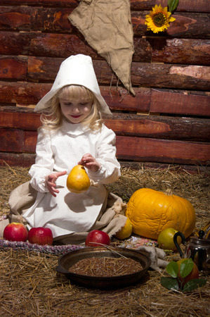 cinderella pumpkin: The girl in the peasants suit in the wooden house