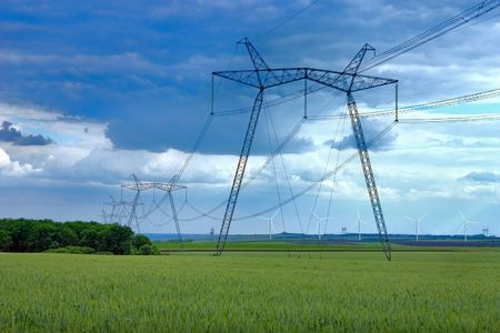eire: Power line and windmill Stock Photo