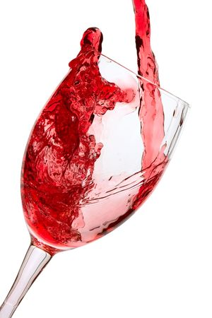 inebriated: Red wine being poured into a wine glass